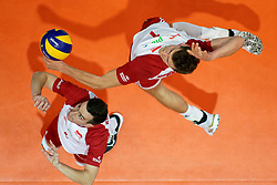 23-09-2019 NED: EC Volleyball 2019 Poland - Germany, Apeldoorn<br /> 1/4 final EC Volleyball - Poland win 3-0 / Piotr Nowakowski #1, Marcin Komenda #4 of Poland