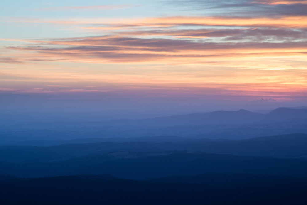 View of Baw Bay Plateau mountain range from the summit of Mount Baw Baw at dusk
