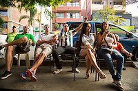 Medellin, Colombia- March 15, 2015: Locals cheer on their team at a local bar in Medellin. CREDIT: Chris Carmichael for The New York Times