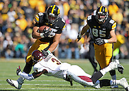 September 22 2012: Iowa Hawkeyes fullback Mark Weisman (45) is hit by Central Michigan Chippewas defensive back Taylor Bradley (3) on a run during the first half of the NCAA football game between the Central Michigan Chippewas and the Iowa Hawkeyes at Kinnick Stadium in Iowa City, Iowa on Saturday September 22, 2012. Central Michigan defeated Iowa 32-31.