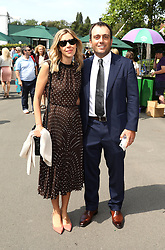 Italian professional golfer Francesco Molinari (right) and wife Valentina Molinari on day seven of the Wimbledon Championships at the All England Lawn Tennis and Croquet Club, London.