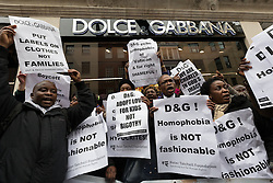© Licensed to London News Pictures. 19/03/2015. London, UK. Demonstrators from The Out and Proud Diamond Group and the Peter Tatchell Foundation protest in support of the international boycott of Dolce and Gabbana outside the Dolce & Gabbana flagship shop in Bond Street, London. Italian designers, Domenico Dolce and Stefano Gabbana spoke out against gay couples adopting, surrogacy and IVF during an interview this week, causing controversy. Photo credit : Vickie Flores/LNP