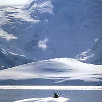 Antarctic Peninsula Inflatable in Antarctica with mountains in background