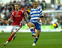 Photo: Gareth Davies.<br />Reading v Charlton Athletic. The Barclays Premiership. 18/11/2006.<br />Reading midfielder James Harper (R) knocks the ball pass Charlton's Dennis Rommedahl (L).