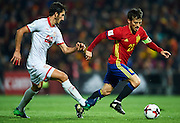 GRANADA, SPAIN - NOVEMBER 12:  David Silva of Spain (R) being followed by Stefan Spirovski of FYR Macedonia (L) during the FIFA 2018 World Cup Qualifier between Spain and FYR Macedonia at  on November 12, 2016 in Granada, .  (Photo by Aitor Alcalde Colomer/Getty Images)