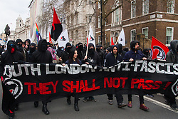 Whitehall, London, April 4th 2015. As PEGIDA UK holds a poorly attended rally on Whitehall, scores of police are called in to contain counter protesters from various London anti-fascist movements. PICTURED: Several dozen anti-fascists march down Whitehall as they counter-protest against PEGIDA.