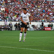 U.S. forward Abby Wambach (20) heads the ball toward the goal during a women's soccer International friendly match between Brazil and the United States National Team, at the Florida Citrus Bowl  on Sunday, November 10, 2013 in Orlando, Florida. The U.S won the game by a score of 4-1.  (AP Photo/Alex Menendez)