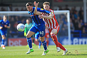 Ian Henderson is fouled by Denver Hume during the EFL Sky Bet League 1 match between Rochdale and Sunderland at Spotland, Rochdale, England on 6 April 2019.