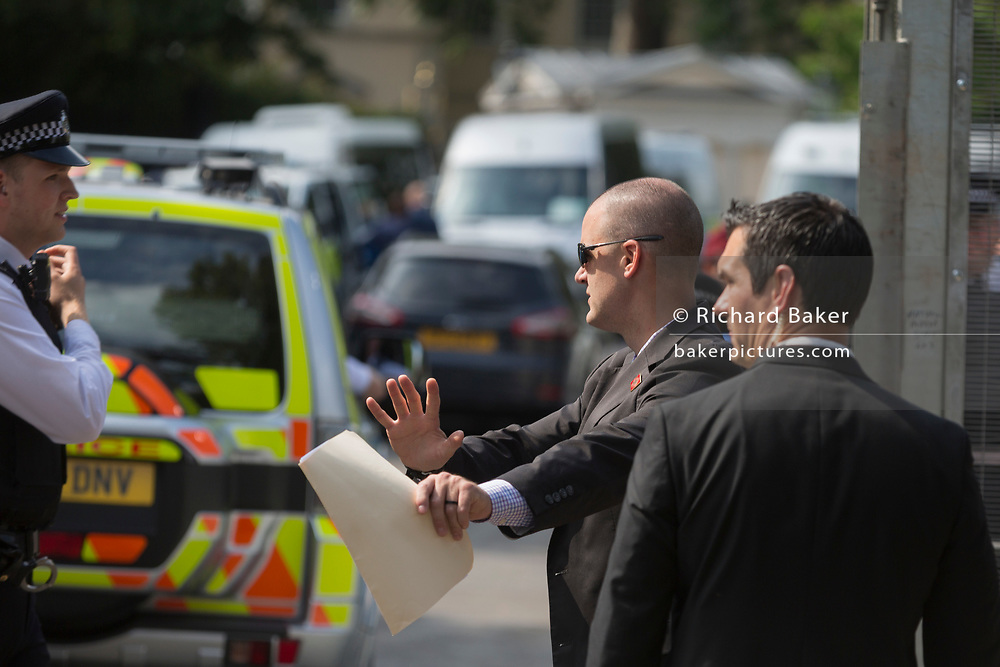 American Secret Service and UK police guard a temporary perimeter fence encircling Winfield House, the official residence of the US Ambassador during the visit to the UK of US President, Donald Trump, on 12th July 2018, in Regent's Park, London, England.
