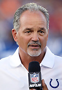 Indianapolis Colts head coach Chuck Pagano is interviewed about the cancellation of the 2016 NFL Pro Football Hall of Fame preseason football game against the Green Bay Packers on Sunday, Aug. 7, 2016 in Canton, Ohio. The game was canceled for player safety reasons due to the condition of the paint on the turf field. (©Paul Anthony Spinelli)