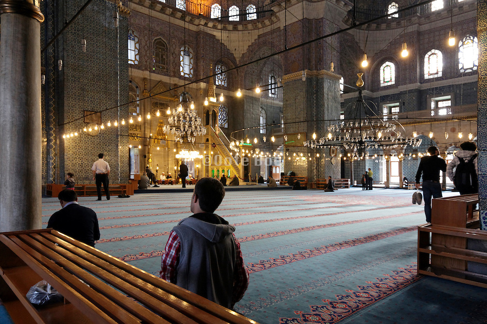 men praying in the Yeni Camii in Istanbul