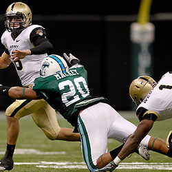 October 9, 2010; New Orleans, LA, USA;  Army Black Knights quarterback Trent Steelman (8) looks to pass as Tulane Green Wave linebacker Trent Mackey (20) dives for a tackle during the first half at the Louisiana Superdome.  Mandatory Credit: Derick E. Hingle