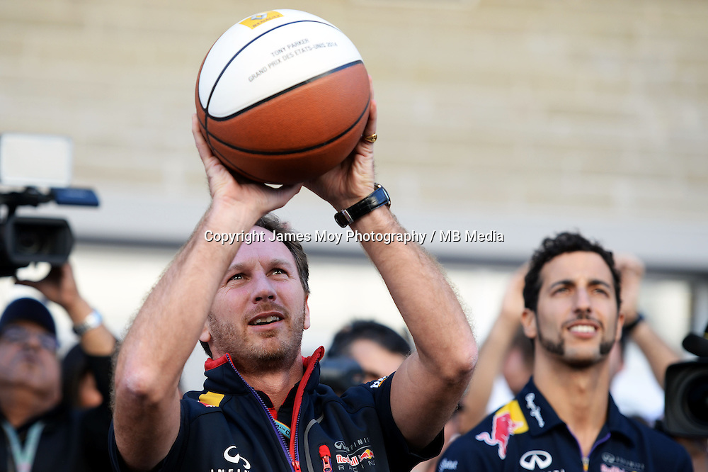 Christian Horner (GBR) Red Bull Racing Team Principal practices his basketball skills with Daniel Ricciardo (AUS) Red Bull Racing (Right).<br /> United States Grand Prix, Saturday 1st November 2014. Circuit of the Americas, Austin, Texas, USA.