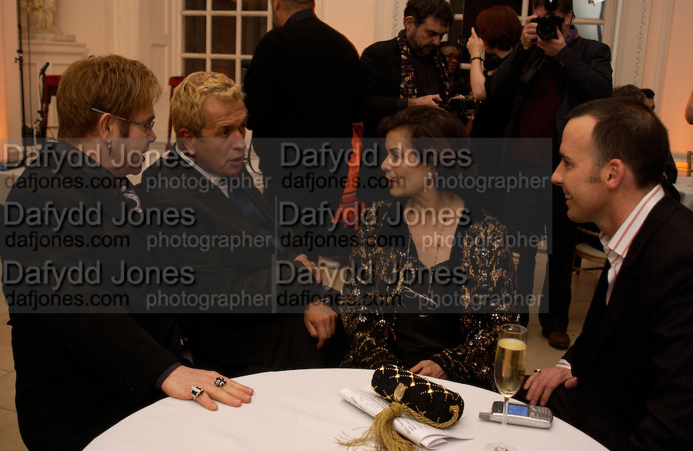 Sir Elton John, Mario Testino, Bianca Jagger and David Furnish. Mario Testino, Bianca Jagger and Kenneth Cole celebrate Women to Women: Positively Speaking. - A publication to raise awareness of women living with Aids. The Orangery, Kensington Palace. 2 December 2004. ONE TIME USE ONLY - DO NOT ARCHIVE  © Copyright Photograph by Dafydd Jones 66 Stockwell Park Rd. London SW9 0DA Tel 020 7733 0108 www.dafjones.com