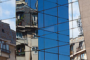 Apartments reflected in the facade of Bucharest Financial Plaza, on Victory Road, Bucharest, Romania