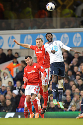Cardiff's Ben Turner  and Tottenham's Emmanuel Adebayor compete for the ball - Photo mandatory by-line: Mitchell Gunn/JMP - Tel: Mobile: 07966 386802 02/03/2014 - SPORT - FOOTBALL - White Hart Lane - London - Tottenham Hotspur v Cardiff City - Premier League