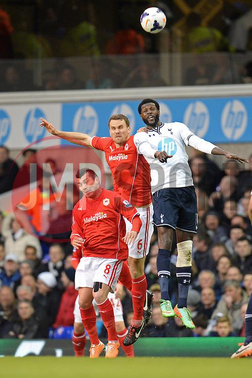 Cardiff's Ben Turner  and Tottenham's Emmanuel Adebayor compete for the ball - Photo mandatory by-line: Mitchell Gunn/JMP - Tel: Mobile: 07966 386802 02/03/2014 - SPORT - FOOTBALL - White Hart Lane - London - Tottenham Hotspur v Cardiff City - Premier League