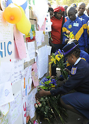 File Photo- Nelson Mandela Dead: Former South African President Has Died At 95. The former South African president had been suffering from a recurring lung infection, Thursday December 05, 2013.<br /> 59900845 <br /> A Police officer presents flowers to former South African president Nelson Mandela outside the hospital where Mandela is treated in Pretoria, South Africa, on June 25, 2013. South Africans on Monday were holding their breath over former President Nelson Mandela's health that has deteriorated from serious to critical. Mandela, 94, has been hospitalised for a recurring lung problem since June 8 2013. Pretoria, South Africa, on June 25, 2013. Picture by imago / i-Images<br /> UK ONLY