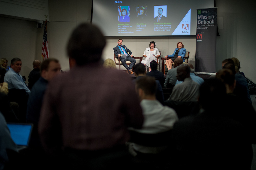 Guest speakers talk on the topic, Mission Critical: An Update on Federal Cybersecurity hosted by Nextgov and underwritten by Adobe in Washington D.C., Aug 11, 2016. Photo Ken Cedeno