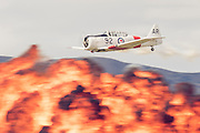 A mock air battle with a Harvard bombing the airfield at Warbirds over Wanaka 2016, New Zealand