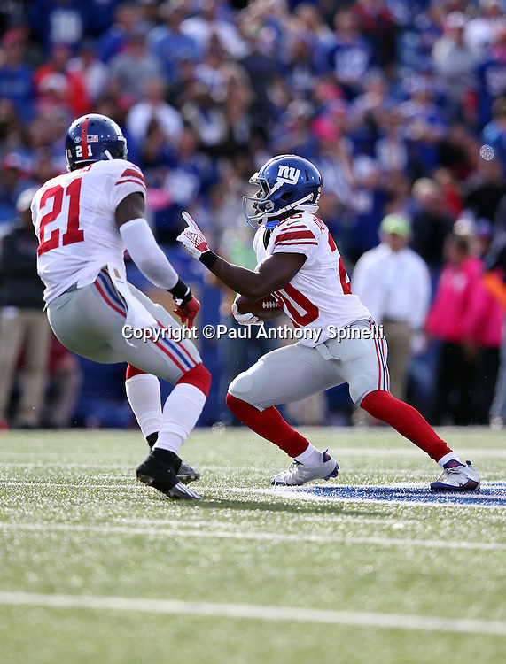 New York Giants free safety Landon Collins (21) looks on as New York Giants cornerback Prince Amukamara (20) runs with the ball after recovering a late fourth quarter fumble that effectively ices the win during the 2015 NFL week 4 regular season football game against the Buffalo Bills on Sunday, Oct. 4, 2015 in Orchard Park, N.Y. The Giants won the game 24-10. (©Paul Anthony Spinelli)