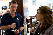 UConn President Susan Herbst speaks with Rich Orr at the Hyatt Regency in Dallas, Texas before watching her school compete in the NCAA Final Four on April 5, 2014. (Cooper Neill / for The New York Times)