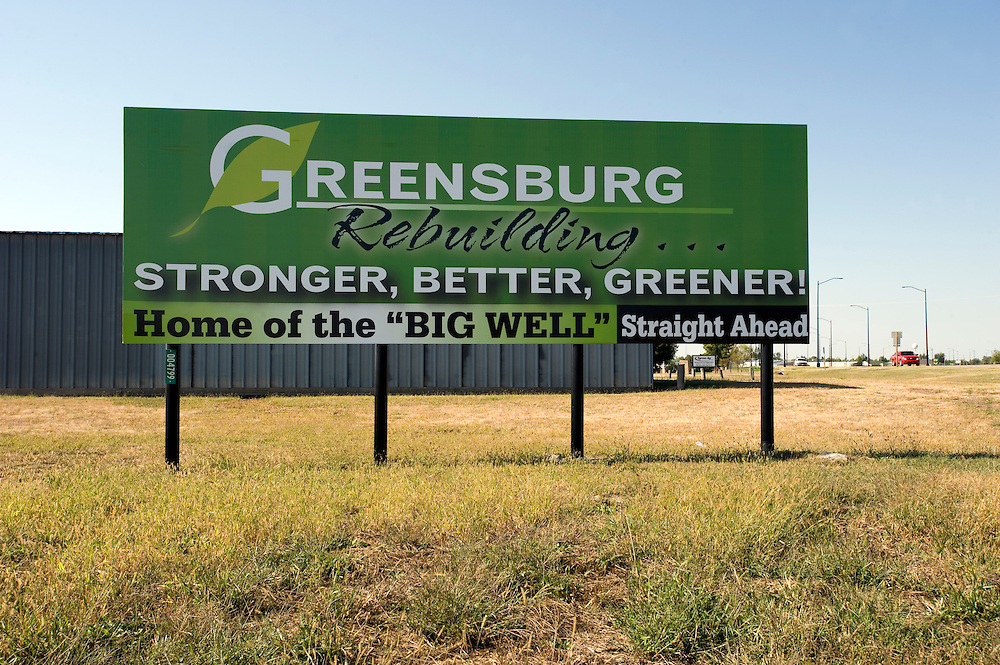 "Greensburg, Kansas, USA..Greensburg sign at the towns entrance. The big well, the world largest hand-dug well, used to be the towns only attraction...""Greensburg: Better, Stronger, Greener!"".On May 4, 2007, an EF5 tornado cut a 1.7-mile path of destruction through Greensburg, Kansas. Winds reaching speeds of 205 miles per hour uprooted trees, demolished homes and leveled the town. Eleven people died and 95% of the buildings were destroyed beyond repair. Residents have since worked furiously to rebuild it in a way that is both economically and environmentally sustainable and to meet the highest environmental standards. Greensburg, whose population has dropped from about 1400 to 800 following the storm and is now growing again, is currently the greenest town in America and the first in the United States to pass a resolution to certify that all city-owned buildings earn LEED Platinum accreditation, the highest level of the LEED rating system...Photo © Stefan Falke"