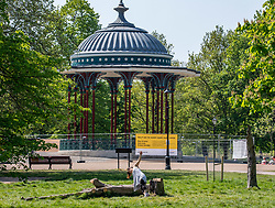 © Licensed to London News Pictures. 24/04/2020. London, UK. A women enjoys the warm weather on Clapham Common while exercising as Londoners go out in the sunshine during lockdown were temperatures are expected to reach 22c over the weekend. London has seen an increase in traffic and busier High Streets as more shops and takeaway restaurants start to open up during the coronavirus pandemic crisis. Photo credit: Alex Lentati/LNP