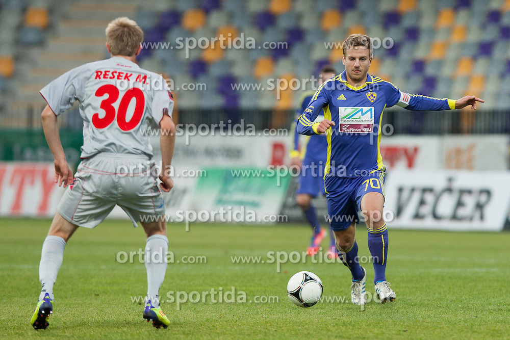 Mitja Resek #30 of NK Aluminij and Ales Mertelj #70 of Maribor during football match between NK Maribor and NK Aluminij in 18th Round of Slovenian First League PrvaLiga NZS 2012/31 on November 7, 2012 in Ljudski vrt, Maribor, Slovenia. (Photo By Gregor Krajncic / Sportida)