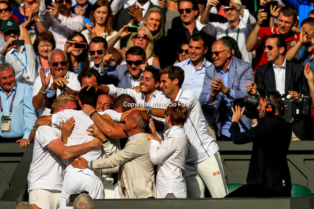 LONDON, ENGLAND - JULY 06: Novak Djokovic of Serbia in with the fans as he climbs up to celebrate in his player's box with friends, family and members of his coaching team following his victory in the Gentlemen's Singles Final match against Roger Federer of Switzerland on day thirteen of the Wimbledon Lawn Tennis Championships at the All England Lawn Tennis and Croquet Club on July 6, 2014 in London, England.