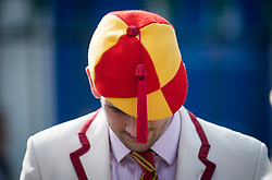 © Licensed to London News Pictures. 04/07/2018. Henley-on-Thames, UK. A man dressed in rowing club colours wears a hat with a tassel on day one of the Henley Royal Regatta, set on the River Thames by the town of Henley-on-Thames in England. Established in 1839, the five day international rowing event, raced over a course of 2,112 meters (1 mile 550 yards), is considered an important part of the English social season. Photo credit: Ben Cawthra/LNP