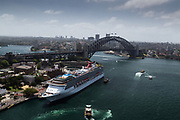 Open Sydney presented by Sydney Living Museuems. This event every year allows Sydneysiders to visit 40 of the city's most significant buildings and spaces across the CBD. Views of Sydney Harbour Bridge and cruise ship from rooftop of AMP Building.