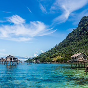 A Bajau Laut village is nothing more than small shacks elevated above the ocean floor on stilts.