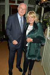 MARTIN LEWIS and PATSY BAKER at a party to celebrate the publication of Right or Wrong: The Memoirs of Lord Bell held at Mark's Club, Charles Street, London on 16th October 2014.