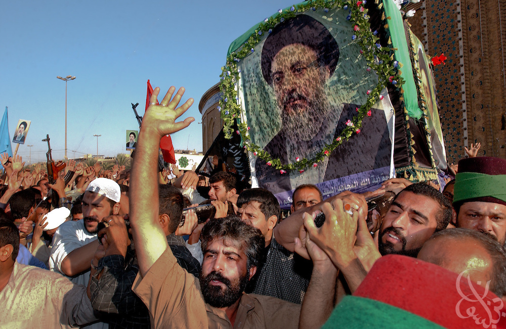 Iraqi Shiites carry the casket during the second day of the funeral procession of Shiite Cleric Mohammed Baqir al-Hakim on September 1, 2003 as it passes through the streets of Karbala, Iraq. Al-Hakim, one of Iraq's most respected clerics, was killed along with more than 85 others when a massive car bomb was detonated following prayers outside the Imam Ali Shrine in the Iraqi city of Najaf on August 29, 2003.