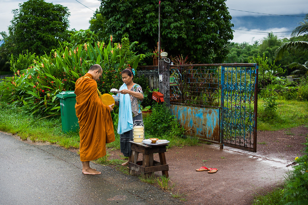 Siri gives monks morning alms, an almost daily ritual for her.
