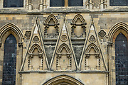"""Sundial over the south door of York Minster. York Minster, built over 250 years 1220-1472 AD, is one of the finest medieval buildings in Europe. Also known as St Peter's, its full name is """"Cathedral and Metropolitical Church of St Peter in York,"""" located in England, United Kingdom, Europe. York Minster is the seat of theArchbishop of York, the second-highest office of the Church of England.""""Minster"""" refers to churches established in the Anglo-Saxon period as missionary teaching churches, and now serves as an honorific title.York was founded by the Romans as Eboracum in 71 AD. As the center of the Church in the North, York Minster has played an important role in great national affairs, such as during the Reformation and Civil War."""