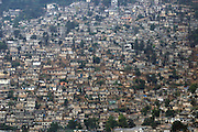 Port-au-Prince, Haiti.<br />Shanty houses and slum dwellings are built all over the city, from the coast up to the mountains. Building on the steep slopes causes erosion.