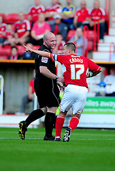 Swindon Town's Paul Caddis protests against the penalty decision - Photo mandatory by-line: Dougie Allward/Josephmeredith.com  - Tel: Mobile:07966 386802 08/08/2012 - SPORT - FOOTBALL - Pre Season - Friendly - Swindon  - County Ground - Swindon Town V Crystal Palace