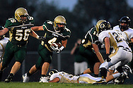 11 SEPT. 2009 -- ST. LOUIS -- Lindbergh High School running back Eric Schwartz ducks behind his offensive line while carrying the ball in the first half against Oakville Friday, Sept. 11, 2009. Lindbergh led Oakville 14-0 at halftime on a pair of touchdowns by Schwartz. Photo © copyright 2009 by Sid Hastings.
