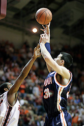 Jason Cain (33) gets a shot off over a Hokie defender.  Cain had a solid performance for the Wahoos with 7 points and 6 rebounds as UVA defeated Tech at home 54-49.