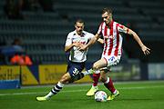 Stoke City defender Liam Lindsay (5) and Preston North End midfielder Billy Bodin (39) during the EFL Sky Bet Championship match between Preston North End and Stoke City at Deepdale, Preston, England on 21 August 2019.