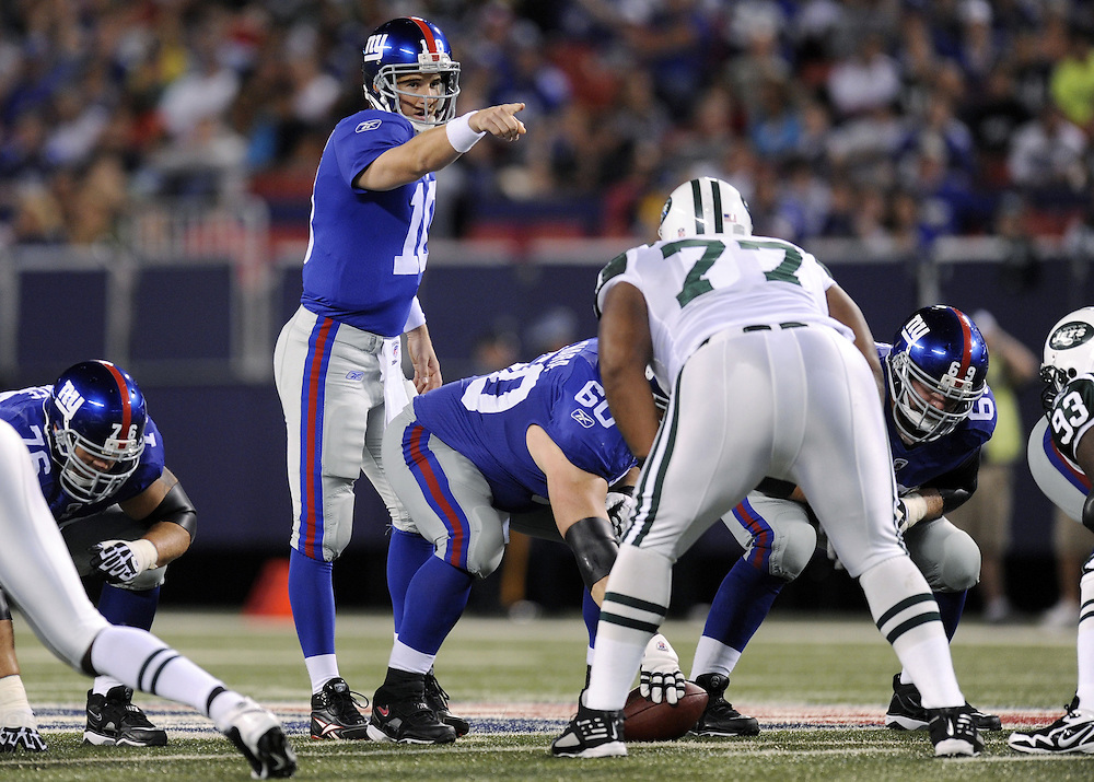 EAST RUTHERFORD, NJ - AUGUST 29: Eli Manning #10 of the New York Giants calls the play against New York Jets in a preseason game at Giants Stadium on August 29, 2009 in East Rutherford, New Jersey. The New York Jets beat the New York Giants 27-25. (Photo by Rob Tringali) *** Local Caption *** Eli Manning