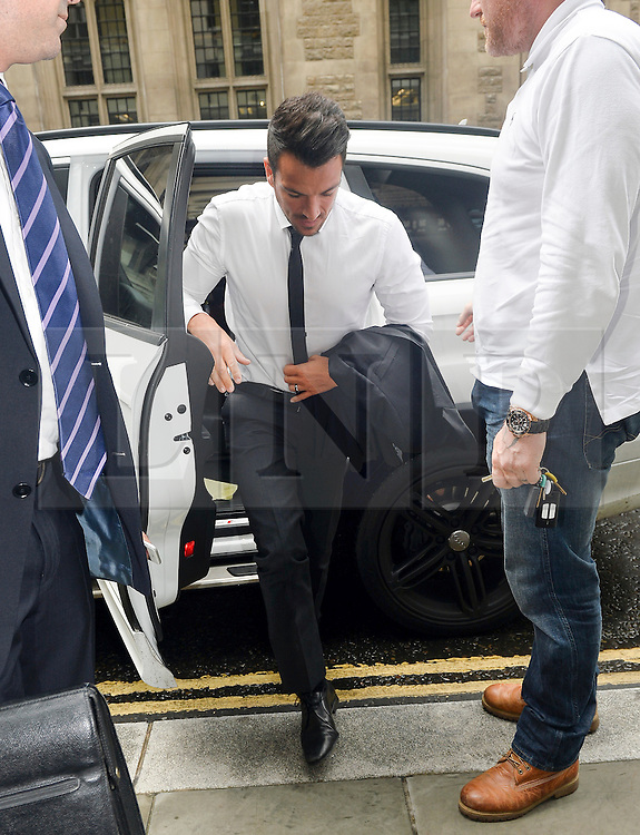 © Licensed to London News Pictures. 15/07/2015. <br /> LONDON, UK. Peter Andre arrives at the High Court today. The reality star and singer has been called as a witness in a contract dispute between his former TV producer Neville Hendricks and ITV2 London, Wednesday 15 July 2015. Photo credit : Hannah McKay/LNP