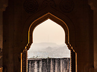 Looking out of a cusped archway in Mehrangarh Fort, Jodhpur, Rajasthan, India.
