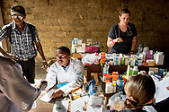 Francis Lahai, a pharmacist from Sierra Leone, dispenses prescriptions to patientson the first day of the LCMS Mercy Medical Team on Monday, May 7, 2018, in the Yardu village outside Koidu, Sierra Leone, West Africa. LCMS Communications/Erik M. Lunsford
