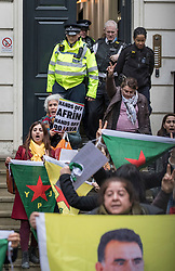 © Licensed to London News Pictures. 29/01/2018. London, UK. Police escort a group of Kurdish women protestors from Conservative Central Office they occupyied it for just over an hour. Police say the group of 12, who are calling on a ban of arms sales to Turkey, entered the building just before 2pm. Photo credit: Peter Macdiarmid/LNP