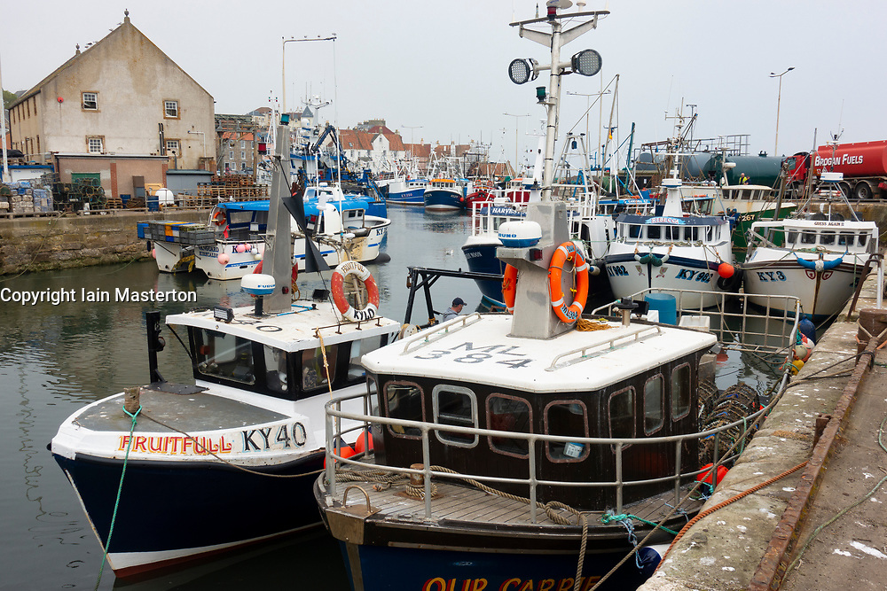 View of fishing boats in harbour at Pittenweem village in the East Neuk of Fife in Scotland, UK