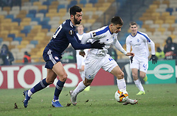 February 21, 2019 - Kiev, Ukraine - Olympiakos' Yassine Meriah, left, and Dynamo Kiev's Nazariy Rusyn, right, in the fight for the ball during the second leg of the Europa League football match of the 32nd stage between Dynamo Kiev and Olympiacos at the Olympic Stadium in Kiev. Ukraine, Thursday, February 21, 2019  (Credit Image: © Danil Shamkin/NurPhoto via ZUMA Press)