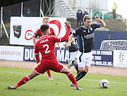 Dundee captain Kevin Thomson skips past Aberdeen&rsquo;s Shaleum Logan - Dundee v Aberdeen, SPFL Premiership at Dens Park<br /> <br />  - &copy; David Young - www.davidyoungphoto.co.uk - email: davidyoungphoto@gmail.com